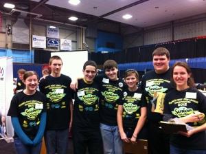 School students volunteering at the First Robotics event.